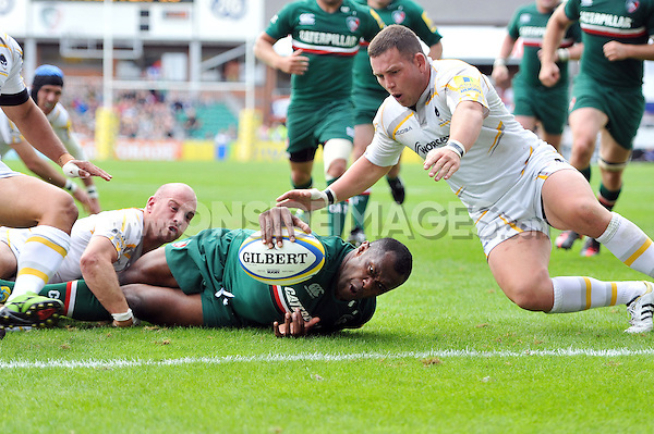 Vereniki Goneva reaches for the try-line that secures Leicester Tigers' bonus point win. Aviva Premiership match, between Leicester Tigers and Worcester Warriors on September 8, 2013 at Welford Road in Leicester, England. Photo by: Patrick Khachfe / JMP