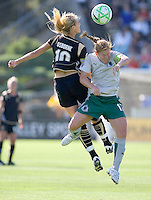 Leslie Osborne (10) and Lori Chalupny (17) jump to head the ball. St. Louis Athletica defeated FC Gold Pride 1-0 at Buck Shaw Stadium in Santa Clara, California on July 5, 2009.