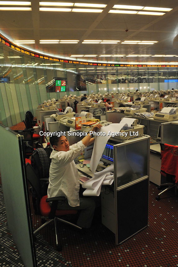 Staff working in Hong Kong Exchange in Hong Kong, China. .