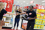 August 20, 2011. Chapel Hill, NC..UNC students hired by Target, hand out free snacks to other students brought from the UNC campus by Target chartered buses on campus move in day. The company hired the buses and staged sales to encourage students to buy items in the store that they might need for their dorm rooms.. Many companies have increased their efforts to reach the youth market by employing popular college students to raise the awareness of the brand by peer to peer marketing on campus' around the country.