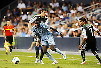 Kei Kamara (23) midfielder Sporting KC goes past Kenny Coper Portland Timbers... Sporting Kansas City defeated Portland Timbers 3-1 at LIVESTRONG Sporting Park, Kansas City, Kansas.