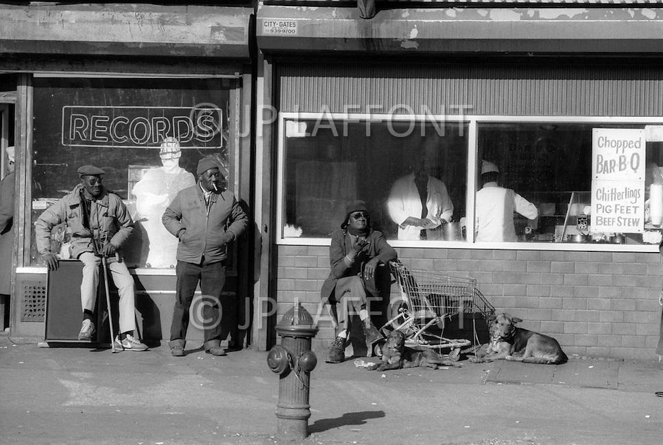 New York City, Harlem, February 1987. Street scene.