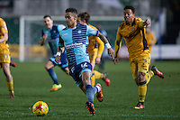 Paris Cowan-Hall of Wycombe Wanderers gets away from Jazzi Barnum-Bobb of Newport County during the Sky Bet League 2 match between Newport County and Wycombe Wanderers at Rodney Parade, Newport, Wales on 22 November 2016. Photo by Mark  Hawkins.