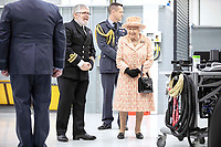 03/02/2020 - Queen Elizabeth II watches air crew at work on a training model F-35B Lightning II fighter at RAF Marham where she inspected the new integrated training centre that trains personnel on the maintenance of the new RAF F-35B Lightning II strike aircraft. Marham, Norfolk. Photo Credit: ALPR/AdMedia