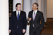 United States President Barack Obama and Prime Minister David Cameron of Great Britain walk along the West Wing Colonnade of the White House in Washington, DC, January 15, 2015. The two leaders will attend a working dinner in the Blue Room. <br /> Credit: Olivier Douliery / Pool via CNP