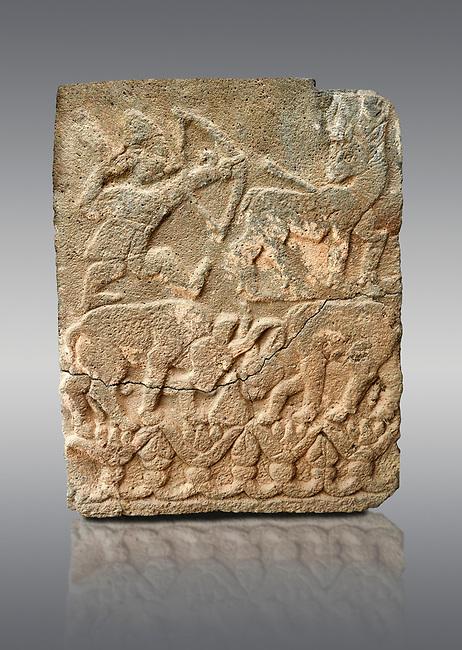 Pictures & images of the North Gate Hittite sculpture stele depicting Hittite hunting. 8th century BC. Karatepe Aslantas Open-Air Museum (Karatepe-Aslantaş Açık Hava Müzesi), Osmaniye Province, Turkey. Against grey background