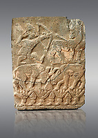 Pictures & images of the North Gate Hittite sculpture stele depicting Hittite hunting. 8th century BC. Karatepe Aslantas Open-Air Museum (Karatepe-Aslantaş Açık Hava Müzesi), Osmaniye Province, Turkey. Against grey background