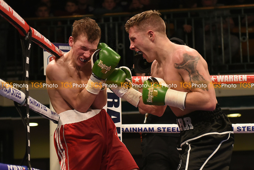 DP Carr (black shorts) defeats Alexandrs Birkenbirgs during a Boxing Show at York Hall, promoted by Frank Warren