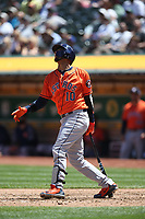 OAKLAND, CA - MAY 9:  Yuli Gurriel #10 of the Houston Astros bats against the Oakland Athletics during the game at the Oakland Coliseum on Wednesday, May 9, 2018 in Oakland, California. (Photo by Brad Mangin)