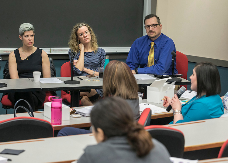 """Doris Rusch, associate professor of game design at DePaul University, Sonya Crabtree-Nelson, assistant professor of social work, DePaul University and Peter DeYoung, emergency department manager at Christus Santa Rosa Hospital in San Antonio, left to right, field questions from the audience during a panel discussion, Wednesday, Feb. 28, 2018, at the DePaul Center on the university's Loop Campus. The conference, """"The Intersection of Traumatic Brain Injury and Domestic Violence"""", brought various community agencies that service victims of domestic violence together with healthcare providers, faculty and students at DePaul and other universities. The participants discussed the links between brain injury and domestic violence and learned new approaches to help survivors and their families. (DePaul University/Jamie Moncrief)"""
