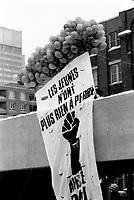 A banner of the REGROUPEMENT AUTONOME DES JEUNES (RAJ) hang outside the Parti Quebecois' Conseil National Extrordinaire at Montreal's convention centre, January 18 and 19, 1985.<br /> <br /> File Photo : Agence Quebec Presse - Pierre Roussel