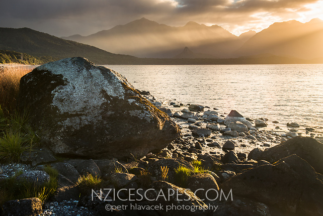 Sunset over Lake Manapouri, Monument and Hunter Mountains in background, Fiordland National Park, UNESCO World Heritage Area, Southland, New Zealand, NZ