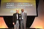 Wales Sport Awards 2013<br /> Ed Thompson receiving his award from Nigel Walker.<br /> 09.11.13<br /> ©Steve Pope-SPORTINGWALES