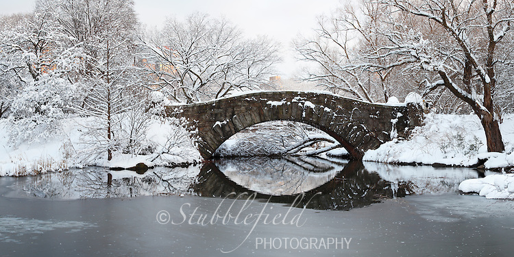 Gapstow Bridge as seen from the Pond on a snowy morning in New York City's Central Park.