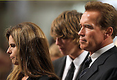 Boston, MA - August 29, 2009 -- Maria Shriver, left, and her husband California Governor Arnold Schwarzenegger, right, during funeral services for U.S. Senator Edward Kennedy at the Basilica of Our Lady of  Perpetual Help in Boston, Massachusetts August 29, 2009.  Senator Kennedy died late Tuesday after a battle with cancer.    .Credit: Brian Snyder- Pool via CNP