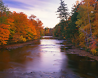 Porcupine Mountains Wilderness State Park, MI:  Autumn hardwood forest and Presque Isle River at dusk