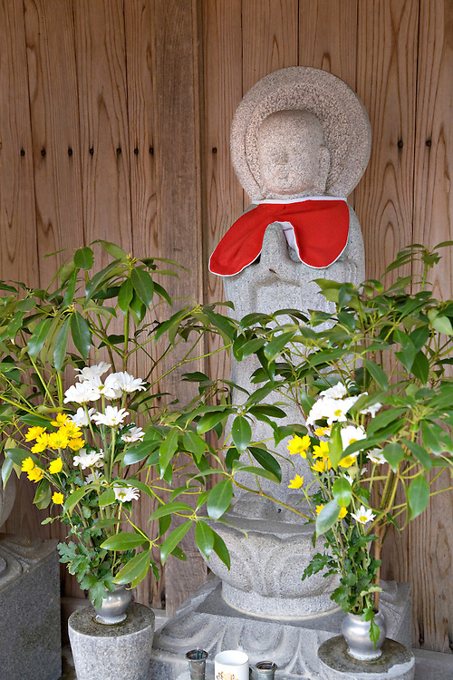 Stone carved Jizo statue in roadside shrine near Takeda Japan