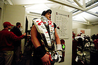 STANFORD, CA-NOVEMBER 30, 2012 - Sam Schwartzstein carries the winner's trophy into the locker room after winning the PAC-12 Championship at Stanford Stadium. The Stanford Cardinal advances to the Rose Bowl with a 27-24 win.