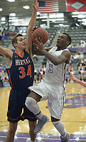 NWA Democrat-Gazette/ANDY SHUPE<br /> Darius Bowers (5) of Fayetteville takes a shot while under pressure from Seth Stanley of Heritage Tuesday, Feb. 13, 2018, during the first half of play in Bulldog Arena in Fayetteville. Visit nwadg.com/photos to see more photographs from the games.