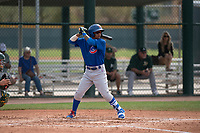 Chicago Cubs second baseman Yeiler Peguero (15) at bat during a Minor League Spring Training game against the Oakland Athletics at Sloan Park on March 13, 2018 in Mesa, Arizona. (Zachary Lucy/Four Seam Images)