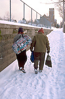 Homeless friends age 41 & 43 walking to the next stop.  St Paul Minnesota USA