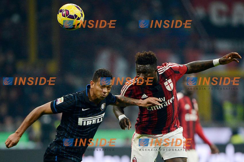 Fredy Guarin Inter, Sulley Muntari Milan<br /> Milano 23-11-2014 Stadio Giuseppe Meazza - Football Calcio Serie A Milan - Inter. Foto Giuseppe Celeste / Insidefoto
