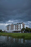 historic Rice Mill Brick building in Charleston South Carolina with Thunderclouds overhead