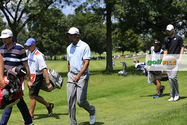 Keegan Bradley, Tiger Woods (USA) and Chris Wood walk off the 2nd tee during Saturday's Round 3 of the 2013 Bridgestone Invitational WGC tournament held at the Firestone Country Club, Akron, Ohio. 3rd August 2013.<br /> Picture: Eoin Clarke www.golffile.ie