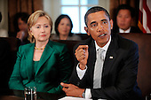 """Washington, DC - September 10, 2009 -- United States President Barack Obama flanked by Secretary of State Hillary Rodham Clinton, meets with members of the Cabinet in the Cabinet Room,September 10, 2009 in Washington, DC. During the meeting President Obama said he accepts the apology of Congressman Joe Wilson (R-S.C.) for yelling out """"You Lie"""" during Obama's speech on healthcare reform to a joint session of Congress..Credit: Olivier Douliery - Pool via CNP"""
