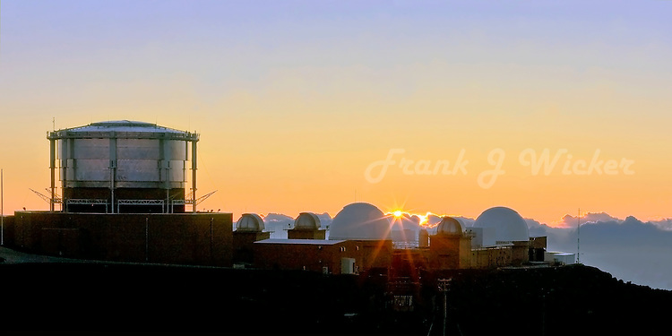 Science City and its observatories bask in the golden light of sunset near HALEAKALA NATIONAL PARK on Maui in Hawaii
