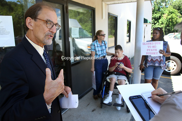 WATERBURY CT. 26 July 2017-072617SV03-Stan Soby, Vice President, Public Policy &amp; External Affairs, left, speaks during a press conference at Oak Hill Day Program in Waterbury Wednesday. The day program was closed for a state furlough day due to the state not having a budget. <br /> Steven Valenti Republican-American