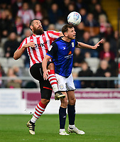 Lincoln City's Michael Bostwick vies for possession with Crewe Alexandra's Chris Porter<br /> <br /> Photographer Chris Vaughan/CameraSport<br /> <br /> The EFL Sky Bet League Two - Lincoln City v Crewe Alexandra - Saturday 6th October 2018 - Sincil Bank - Lincoln<br /> <br /> World Copyright &copy; 2018 CameraSport. All rights reserved. 43 Linden Ave. Countesthorpe. Leicester. England. LE8 5PG - Tel: +44 (0) 116 277 4147 - admin@camerasport.com - www.camerasport.com