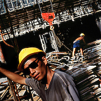 Labourers workers engaged in the construction of a new hotel.