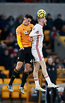 Oli McBurnie of Sheffield Utd and Max Kilman of Wolverhampton Wanderers during the Premier League match at Molineux, Wolverhampton. Picture date: 1st December 2019. Picture credit should read: Simon Bellis/Sportimage