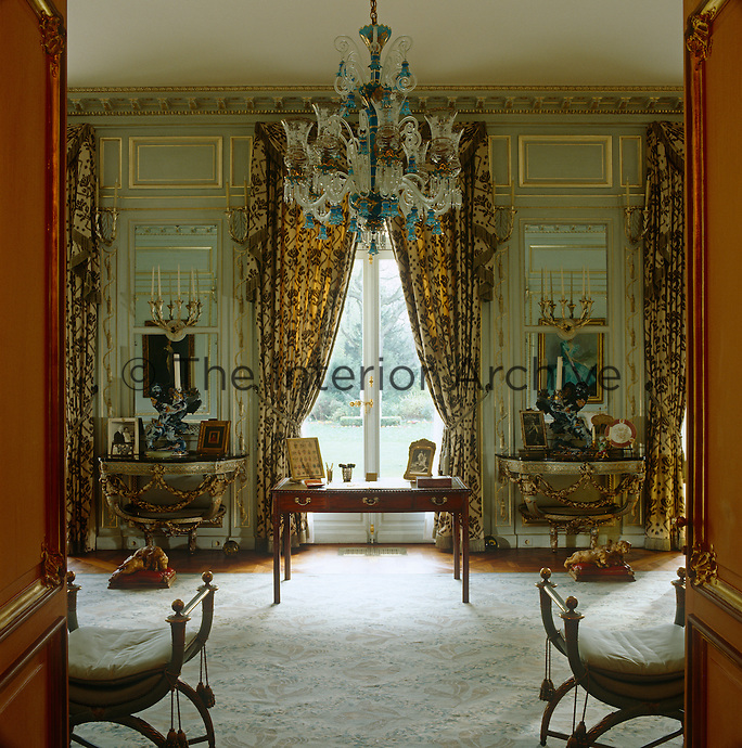 The antique table in front of the window in the salon was used by the Duke of Windsor when he signed the Instrument of Abdication
