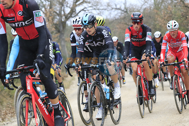 The peloton on gravel sector 2 Bagnaia during the 2017 Strade Bianche running 175km from Siena to Siena, Tuscany, Italy 4th March 2017.<br /> Picture: Eoin Clarke   Newsfile<br /> <br /> <br /> All photos usage must carry mandatory copyright credit (&copy; Newsfile   Eoin Clarke)