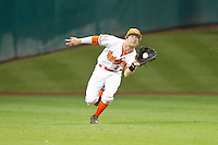 Sam Houston State Bearkats center fielder Colt Atwood #11 makes a running catch against the Texas Longhorns at Minute Maid Park on March 2, 2014 in Houston, Texas.  The Longhorns defeated the Bearkats 3-2 to finish the tournament 3-0.  (Brian Westerholt/Four Seam Images)