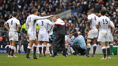 27.11.2010. Chris Ashton of EnglandI receives treatment. international Rugby England vs South Africa at Twickenham Stadium, England.