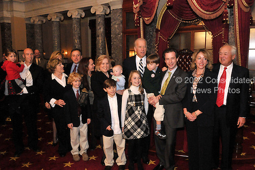 Washington, DC - January 27, 2009 -- United States Senator Kirsten Gillibrand (Democrat of New York) poses with United States Vice Joseph Biden and her family after recreating her swearing-into office  in the Old Senate Chamber of the United States Capitol in Washington, D.C. on Tuesday, January 27, 2009..Credit: Ron Sachs / CNP.(RESTRICTION: NO New York or New Jersey Newspapers or newspapers within a 75 mile radius of New York City)