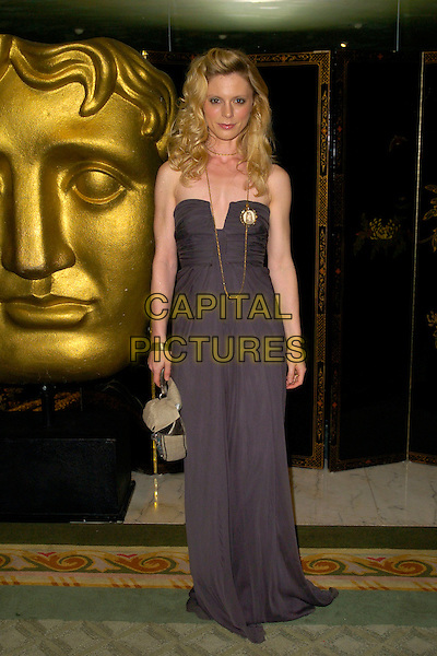 EMILIA FOX.At the British Academy Television Craft Awards (BAFTA), the Dorchester, London, England..April 22nd, 2007.full length grey gray strapless dress gold necklace beige purse bag .CAP/BEL.©Belcher/Capital Pictures
