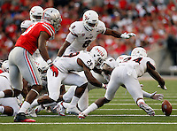 Northern Illinois players fall on a fumble by Ohio State Buckeyes running back Curtis Samuel (4) during the fourth quarter of the NCAA football game at Ohio Stadium in Columbus on Sept. 19, 2015. (Adam Cairns / The Columbus Dispatch)