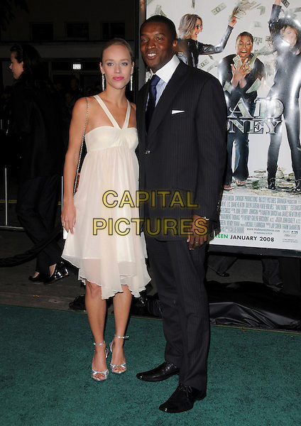 """JOSEPHINE JACOB & ROGER CROSS.Overature Pictures' L.A. Premiere of """"Mad Money"""" held at The Mann Village Theatre in Westwood, California, USA..January 9th, 2008.full length black dress suit white cream married husband wife                           .CAP/DVS.©Debbie VanStory/Capital Pictures"""