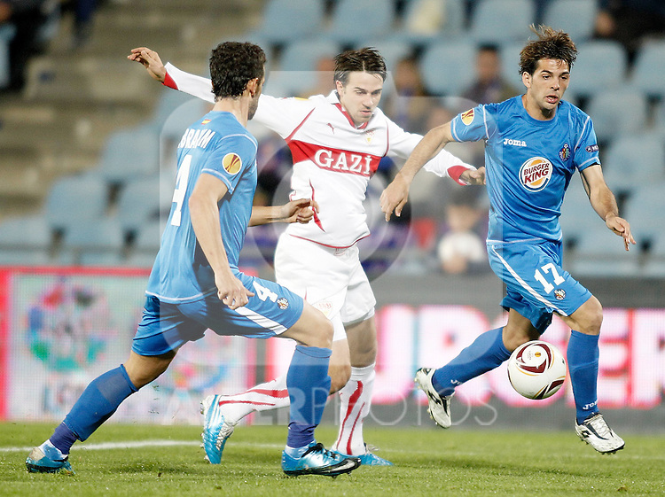 Stuttgart's Martin Harnik against Getafe's Victor Sanchez during Europa League match. November 04, 2010. (ALTERPHOTOS/Alvaro Hernandez).