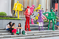 Women Sitting by Modern Fashion Sculptures outside ION Mall, Singapore, Orchard Road Street Scene.  Urban People by Kurt Lorenz Metzler.