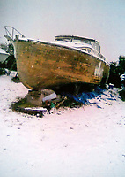 BNPS.co.uk (01202 558833)<br /> Pic: RobertMorley/BNPS.<br /> <br /> Sorry state - Robert discovered the boat almost forgotten in a Weston-super-Mare boatyard.<br /> <br /> The world's first drone boat is rediscovered - after 100 years in the shadows.<br /> <br /> A historic British torpedo boat, which was converted into the world's first remotely controlled 'drone vessel' as part of a top secret project at the end of the Great War has been painstakingly researched and restored after being discovered rotting in a West country boatyard.<br /> <br /> The pioneering CMB9/DCB1 was one of 12 Coastal Motor Boats (CMBs) built by the Admiralty in 1916 to target German destroyers.<br /> <br /> The fast, lightweight 40ft motor torpedo boat, which could travel at 40 knots, sunk the German destroyer G88 off Zebrugge in Belgium in 1917.<br /> <br /> Subsequently, it was one of four vessels converted into Distance Control Boats (DCBs) for top secret trials to see if unmanned patrol boats with torpedoes could be radio controlled via aircraft and directed towards enemy targets.<br /> <br /> The boat was found in a sorry state covered in brambles in a boat yard in Weston-super-Mare, Somerset, by marine surveyor Robert Morley a decade ago, who has spent tens of thousands of pounds restoring and researching it's colourful history.