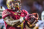 Florida State running back Dalvin Cook holds the ball out as he scores the game winning touchdown in the second half of an NCAA college football game against Miami in Tallahassee, Fla., Saturday, Oct. 10, 2015.   The Florida State Seminoles defeated the Miami Hurricanes 29-24.