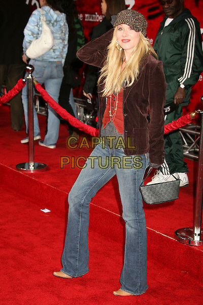 """CHRISTINA APPLEGATE.""""The Number 23"""" Los Angeles Premiere at the Orpheum Theater, Los Angeles, California, USA..February 13th, 2007.grey gray hat full length brown velvet jacket jeans purse bag.CAP/ADM/BP.©Byron Purvis/AdMedia/Capital Pictures"""