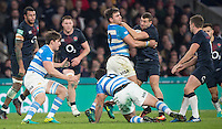 Twickenham, United Kingdom.  Facundo ISA, get's to grips with Jonny MAY, during the Old Mutual Wealth Series Rest Match: England vs Argentina, at the RFU Stadium, Twickenham, England, <br /> <br /> Saturday  26/11/2016<br /> <br /> [Mandatory Credit; Peter Spurrier/Intersport-images]