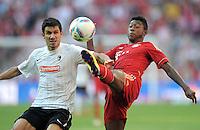 FUSSBALL   1. BUNDESLIGA  SAISON 2011/2012   5. Spieltag FC Bayern Muenchen - SC Freiburg         10.09.2011 Mensur Mujdza (li, SC Freiburg) gegen David Alaba (re, FC Bayern Muenchen)