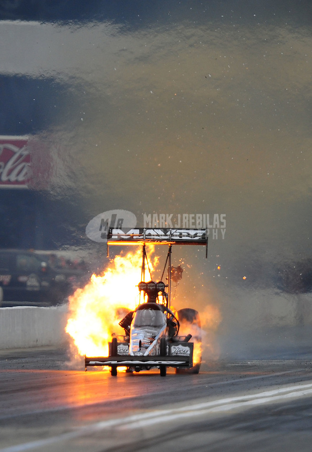 Nov. 12, 2011; Pomona, CA, USA; NHRA top fuel dragster driver Dom Lagana explodes an engine during qualifying at the Auto Club Finals at Auto Club Raceway at Pomona. Mandatory Credit: Mark J. Rebilas-.